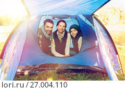 Купить «happy family in tent at camp site», фото № 27004110, снято 27 сентября 2015 г. (c) Syda Productions / Фотобанк Лори