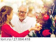 Купить «grandfather and granddaughter at christmas tree», фото № 27004418, снято 14 сентября 2014 г. (c) Syda Productions / Фотобанк Лори
