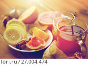 Купить «ginger tea with honey, citrus and garlic on wood», фото № 27004474, снято 13 октября 2016 г. (c) Syda Productions / Фотобанк Лори