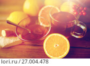 Купить «tea with honey, orange and rowanberry on wood», фото № 27004478, снято 13 октября 2016 г. (c) Syda Productions / Фотобанк Лори