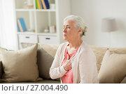Купить «senior woman suffering from heartache at home», фото № 27004490, снято 20 июня 2017 г. (c) Syda Productions / Фотобанк Лори