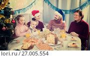 Купить «Happy family members making conversation», фото № 27005554, снято 25 мая 2018 г. (c) Яков Филимонов / Фотобанк Лори