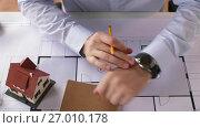 Купить «architect checking time on wristwatch and leaving», видеоролик № 27010178, снято 7 сентября 2017 г. (c) Syda Productions / Фотобанк Лори
