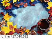 Autumn leaves, cup of tea and scarf on blue background. Стоковое фото, фотограф Оксана Голева / Фотобанк Лори