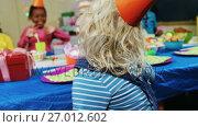 Купить «Kids having fun during birthday party 4k», видеоролик № 27012602, снято 24 января 2020 г. (c) Wavebreak Media / Фотобанк Лори
