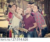 Купить «Positive colleagues making mutual photo», фото № 27014626, снято 14 августа 2018 г. (c) Яков Филимонов / Фотобанк Лори