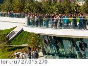 Купить «Moscow, Russia - September 23. 2017. Tourists on observation deck in new park Zaryadye.», фото № 27015270, снято 23 сентября 2017 г. (c) Володина Ольга / Фотобанк Лори