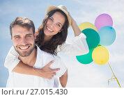 Купить «Millennial couple piggy back against sunny sky and baloons», фото № 27015430, снято 19 августа 2018 г. (c) Wavebreak Media / Фотобанк Лори