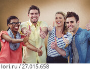 Купить «Millennial team giving thumbs up against brown background», фото № 27015658, снято 18 октября 2018 г. (c) Wavebreak Media / Фотобанк Лори