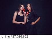 Купить «Attractive girls in the image of vampires hold glasses with blood. Halloween.», фото № 27026862, снято 22 сентября 2017 г. (c) Женя Канашкин / Фотобанк Лори