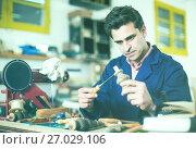 Купить «Joiner working in workshop», фото № 27029106, снято 8 апреля 2017 г. (c) Яков Филимонов / Фотобанк Лори