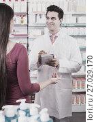 pharmacist serving woman in pharmacy. Стоковое фото, фотограф Яков Филимонов / Фотобанк Лори