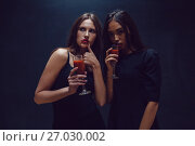Купить «Attractive girls in the image of vampires hold glasses with blood. Halloween.», фото № 27030002, снято 22 сентября 2017 г. (c) Женя Канашкин / Фотобанк Лори