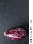 Купить «Close-up of eggplant on slate», фото № 27031142, снято 12 июня 2017 г. (c) Wavebreak Media / Фотобанк Лори