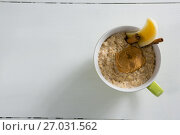 Купить «Cup of oats with peanut butter and cinnamon sticks», фото № 27031562, снято 13 июня 2017 г. (c) Wavebreak Media / Фотобанк Лори