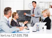 Купить «Businessman presenting new strategy to partners», фото № 27035758, снято 1 июля 2017 г. (c) Яков Филимонов / Фотобанк Лори