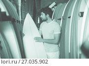 Купить «male surfer holding professional surfboard», фото № 27035902, снято 22 августа 2017 г. (c) Яков Филимонов / Фотобанк Лори
