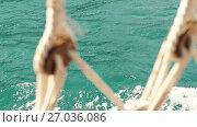 Купить «Look Through the Ropes of Ship at Sea», видеоролик № 27036086, снято 27 сентября 2017 г. (c) Илья Шаматура / Фотобанк Лори