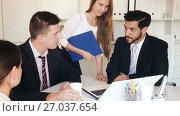 Купить «Group of confident business colleagues planning work at joint meeting», видеоролик № 27037654, снято 11 августа 2017 г. (c) Яков Филимонов / Фотобанк Лори