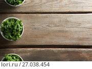 Купить «Kale arranged in bowls on table», фото № 27038454, снято 12 июня 2017 г. (c) Wavebreak Media / Фотобанк Лори