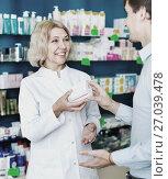 Female pharmacist counseling customer about drugs usage. Стоковое фото, фотограф Яков Филимонов / Фотобанк Лори