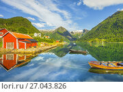 Купить «Snow capped mountains and red boathouse mirroring in the blue water of the Sognefjord at Balestrand, Norway, Scandinavia.», фото № 27043826, снято 4 июля 2017 г. (c) age Fotostock / Фотобанк Лори
