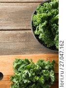 Купить «Fresh kale at wooden table», фото № 27047162, снято 12 июня 2017 г. (c) Wavebreak Media / Фотобанк Лори