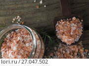 Купить «Himalayan salt and rosemary on wooden table», фото № 27047502, снято 5 июня 2017 г. (c) Wavebreak Media / Фотобанк Лори