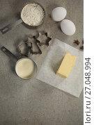 Купить «High angle view of butter on wax paper by ingredients», фото № 27048994, снято 5 мая 2017 г. (c) Wavebreak Media / Фотобанк Лори