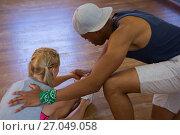 Купить «Side view of man assisting female dancer in stretching», фото № 27049058, снято 17 мая 2017 г. (c) Wavebreak Media / Фотобанк Лори