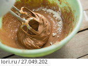 Купить «Overhead view of electric mixer mixing flour and chocolate batter in bowl», фото № 27049202, снято 5 мая 2017 г. (c) Wavebreak Media / Фотобанк Лори