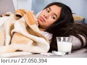 Sick girl at home lying at sofa. Стоковое фото, фотограф Яков Филимонов / Фотобанк Лори