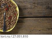Cereal bran sticks with spoon in plate. Стоковое фото, агентство Wavebreak Media / Фотобанк Лори
