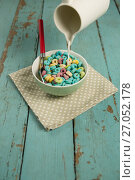 Купить «Milk being pour into glass of cereal rings», фото № 27052178, снято 13 июня 2017 г. (c) Wavebreak Media / Фотобанк Лори