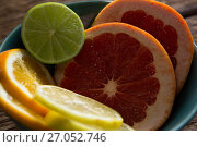 Купить «Various citrus slices in bowl», фото № 27052746, снято 12 июня 2017 г. (c) Wavebreak Media / Фотобанк Лори