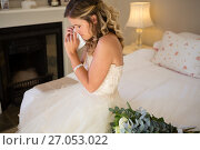 Купить «Sad bride crying while sitting on bed», фото № 27053022, снято 2 мая 2017 г. (c) Wavebreak Media / Фотобанк Лори