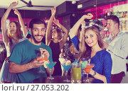 Купить «Man with woman are drinking cocktails on corporate party.», фото № 27053202, снято 2 августа 2017 г. (c) Яков Филимонов / Фотобанк Лори