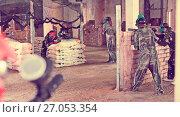 Купить «players are targeting in opponents from cover in battlefield», фото № 27053354, снято 10 июля 2017 г. (c) Яков Филимонов / Фотобанк Лори