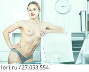 Купить «Portrait of young girl in underpants in the office», фото № 27053554, снято 24 апреля 2017 г. (c) Яков Филимонов / Фотобанк Лори