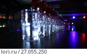 Купить «Bar, club, close-up, cocktails in a row, blurred background», видеоролик № 27055250, снято 26 июля 2017 г. (c) Артём Зайцев / Фотобанк Лори
