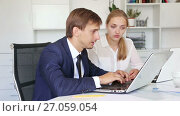 Купить «young sad man and woman coworkers experiencing business failure in firm office», видеоролик № 27059054, снято 9 августа 2016 г. (c) Яков Филимонов / Фотобанк Лори