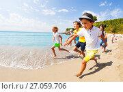 Купить «Kids run a race in shallow sea water», фото № 27059706, снято 20 июля 2017 г. (c) Сергей Новиков / Фотобанк Лори