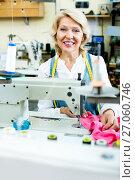 Купить «Mature woman sewing with professional machine», фото № 27060746, снято 19 июня 2019 г. (c) Яков Филимонов / Фотобанк Лори