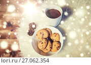 Купить «cups of hot chocolate with cookies on fur rug», фото № 27062354, снято 1 октября 2015 г. (c) Syda Productions / Фотобанк Лори