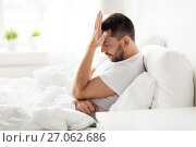 Купить «stressed man in bed at home», фото № 27062686, снято 6 мая 2017 г. (c) Syda Productions / Фотобанк Лори