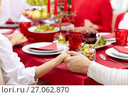 Купить «family having holiday dinner and praying at home», фото № 27062870, снято 14 сентября 2014 г. (c) Syda Productions / Фотобанк Лори