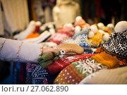 Купить «woman buying woolen mittens at christmas market», фото № 27062890, снято 1 декабря 2016 г. (c) Syda Productions / Фотобанк Лори