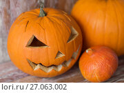 Купить «jack-o-lantern or carved halloween pumpkin», фото № 27063002, снято 18 сентября 2017 г. (c) Syda Productions / Фотобанк Лори