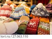 Купить «woman buying woolen mittens at christmas market», фото № 27063110, снято 1 декабря 2016 г. (c) Syda Productions / Фотобанк Лори