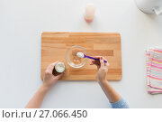 Купить «hands with spoon and jar making baby cereal», фото № 27066450, снято 21 февраля 2017 г. (c) Syda Productions / Фотобанк Лори